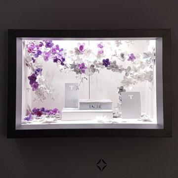 fleurs en papiers pour les vitrines tache lors du salon baselworld